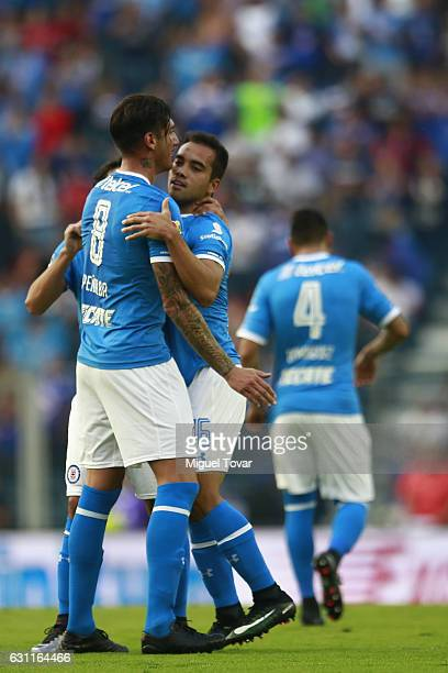 Adrian Aldrete of Cruz Azul celebrates with teammate Gabriel Penalba after scoring the first goal of his team during the 1st round match between Cruz...