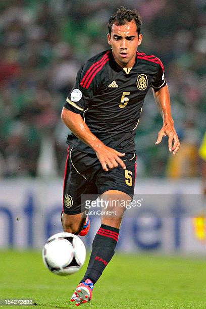 Adrian Aldrete of Mexico conducts the ball during a match between El Salvador and Mexico as part of the CONCACAF Qualifiers for Brazil 2014 FIFA...