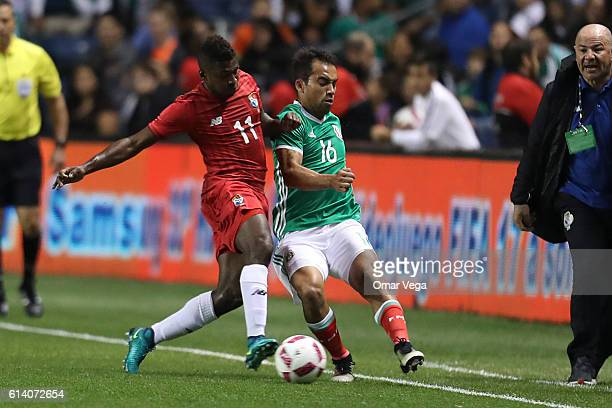 Adrian Aldrete of Mexico fights for the ball with Armando Cooper of Panama during the International Friendly Match between Mexico and Panama at...