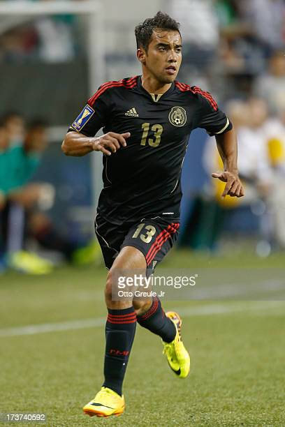 Adrian Aldrete of Mexico follows the play against Canada at CenturyLink Field on July 11 2013 in Seattle Washington