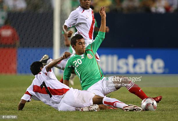 Adrian Aldrete of Mexico is tackled Nolberto Solano of Peru during a international friendly match on June 8 2008 at Soldier Field in Chicago Illinois...