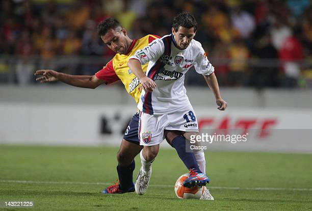 Adrian Aldrete of Morelia struggles for the ball with Juan Cuevas of Atlante during a match between Morelia and Atlante as part of the Torneo...