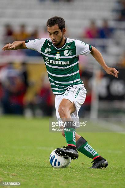 Adrian Aldrete of Santos drives the ball during a match between Leones Negros and Santos Laguna as part of 15th round Apertura 2014 Liga MX at...