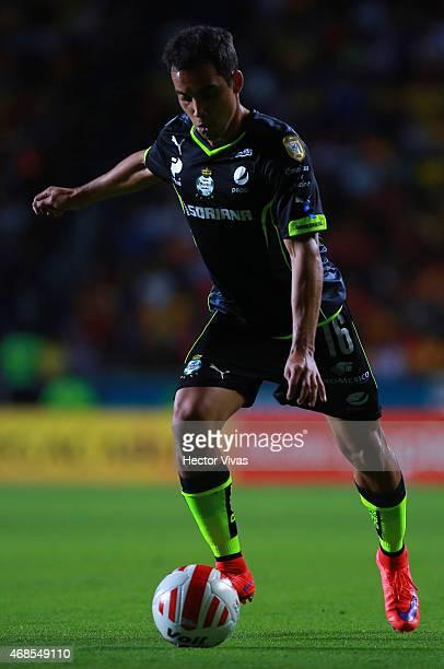 Adrian Aldrete of Santos Laguna drives the ball during a match between Morelia and Santos Laguna as part of 12th round of Clausura 2015 Liga MX at...