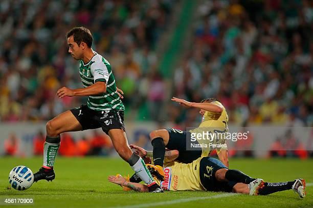Adrian Aldrete of Santos runs over defenders during a match between Santos Laguna and America as part of 10th round Apertura 2014 Liga MX at Corona...