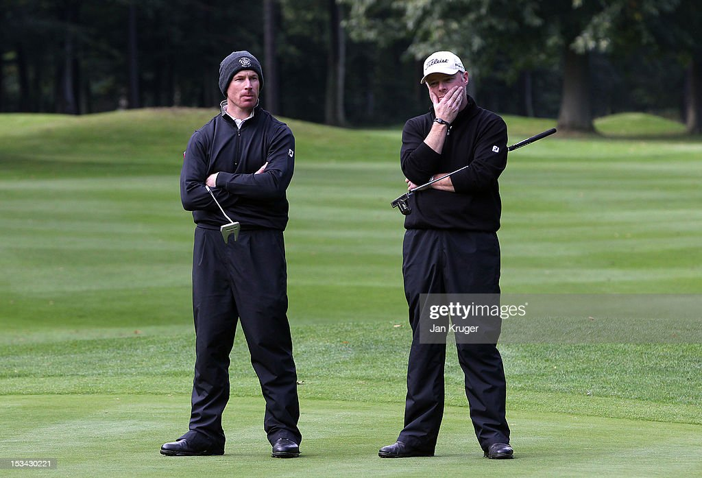 Adrian Ambler of Low Laithes GC and partner Aran Wainwright of Mid Yorkshire GC looks on during the final round of the Skins PGA Fourball Championship at Forest Pines Hotel & Golf Club on October 5, 2012 in Broughton, England.