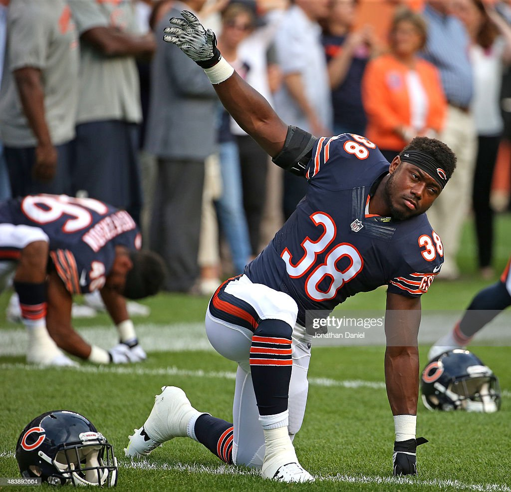 <a gi-track='captionPersonalityLinkClicked' href=/galleries/search?phrase=Adrian+Amos&family=editorial&specificpeople=8489598 ng-click='$event.stopPropagation()'>Adrian Amos</a> #38 of the Chicago Bears stretches during warm-ups before a preseason game against the Miami Dolphins at Soldier Field on August 13, 2015 in Chicago, Illinois.