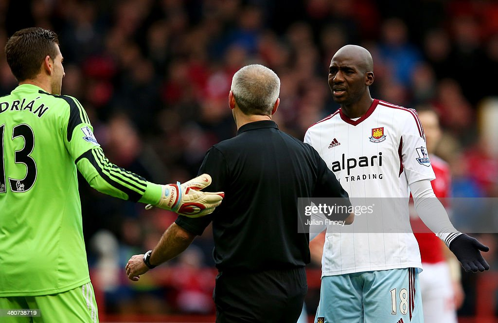 Adrian (L) and <a gi-track='captionPersonalityLinkClicked' href=/galleries/search?phrase=Alou+Diarra&family=editorial&specificpeople=465019 ng-click='$event.stopPropagation()'>Alou Diarra</a> of West Ham United (R) protest to referee Martin Atkinson as he awards a penalty kick to Nottingham Forest during the FA Cup with Budweiser Third round match between Nottingham Forest and West Ham United at City Ground on January 5, 2014 in Nottingham, England.