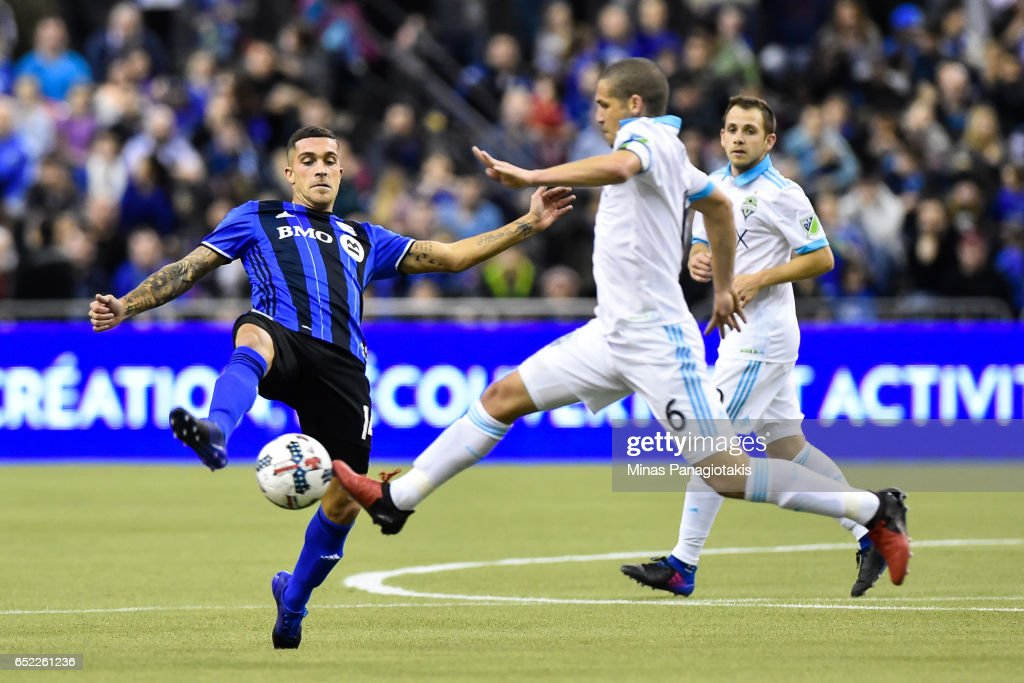 Adrian Arregui #14 of the Montreal Impact tries to play the ball past Osvaldo Alonso #6 of the Seattle Sounders during the MLS game at Olympic Stadium on March 11, 2017 in Montreal, Quebec, Canada. The Seattle Sounders FC and the Montreal Impact end up in a 2-2 draw.