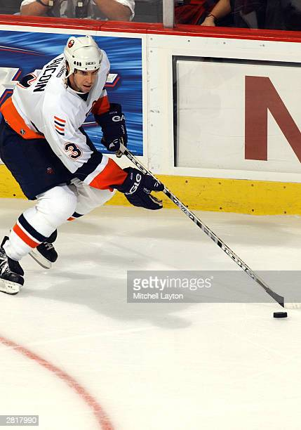Adrian Aucoin of the New York Islanders controls the puck during the game against the Washington Capitals at the MCI Center on October 9 2003 in...