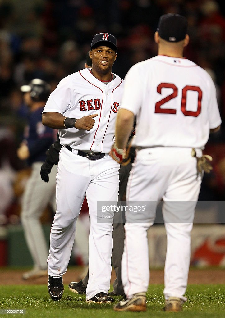 Adrian Beltre #29 and Kevin Youkilis #20 of the Boston Red Sox celebrate the win over the Minnesota Twins on May 19, 2010 at Fenway Park in Boston, Massachusetts. The Red Sox defeated the Twins 3-2.