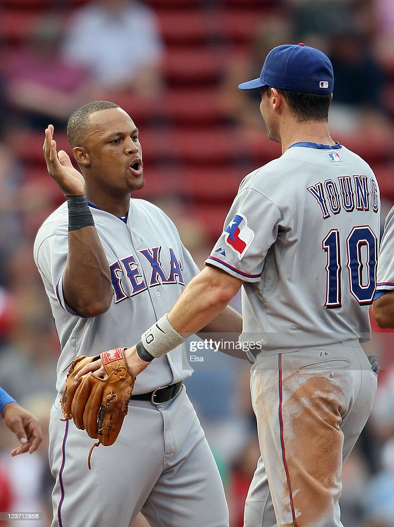 <a gi-track='captionPersonalityLinkClicked' href=/galleries/search?phrase=Adrian+Beltre&family=editorial&specificpeople=202631 ng-click='$event.stopPropagation()'>Adrian Beltre</a> #29 and <a gi-track='captionPersonalityLinkClicked' href=/galleries/search?phrase=Michael+Young+-+Baseball+Player&family=editorial&specificpeople=203149 ng-click='$event.stopPropagation()'>Michael Young</a> #10 of the Texas Rangers celebrate the win over the Boston Red Sox on September 4, 2011 at Fenway Park in Boston, Massachusetts.The Texas Rangers defeated the Boston Red Sox 11-4.