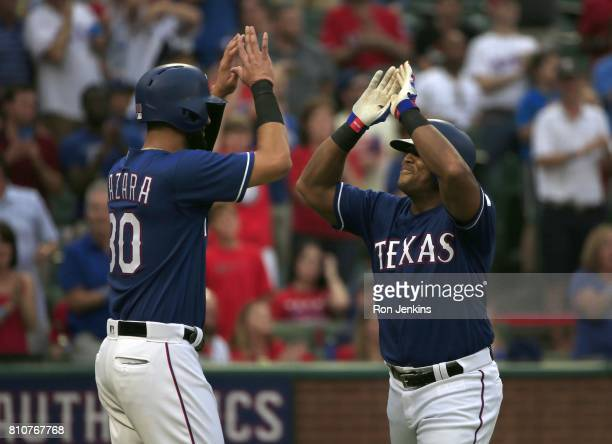 Adrian Beltre and Nomar Mazara of the Texas Rangers celebrate Beltre's threerun home run against the Los Angeles Angels of Anaheim during the second...