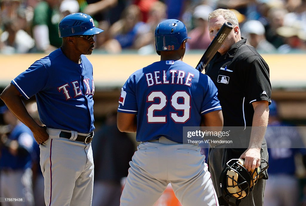 <a gi-track='captionPersonalityLinkClicked' href=/galleries/search?phrase=Adrian+Beltre&family=editorial&specificpeople=202631 ng-click='$event.stopPropagation()'>Adrian Beltre</a> #29 and third base coach Gary Pettis #24 argues a call third strike on Beltre with home plate umpire Bill Miller #26 during the third inning against the Oakland Athletics at O.co Coliseum on August 4, 2013 in Oakland, California.