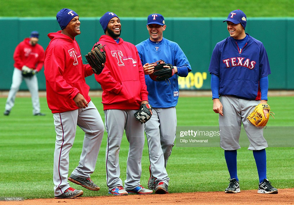 Adrian Beltre Elvis Andrus Michael Young and Ian Kinsler stand in the field during batting practice and at Busch Stadium on October 18 2011 in St...