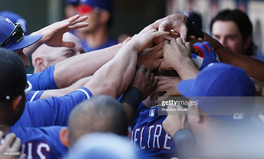 <a gi-track='captionPersonalityLinkClicked' href=/galleries/search?phrase=Adrian+Beltre&family=editorial&specificpeople=202631 ng-click='$event.stopPropagation()'>Adrian Beltre</a> #29 of the Texas Ranger is congratulated by teammates after hitting a two-run homerun in the fifth inning of a baseball game against the Los Angeles Angels at Globe Life Park on October 4, 2015 in Arlington, Texas.