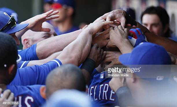 Adrian Beltre of the Texas Ranger is congratulated by teammates after hitting a tworun homerun in the fifth inning of a baseball game against the Los...