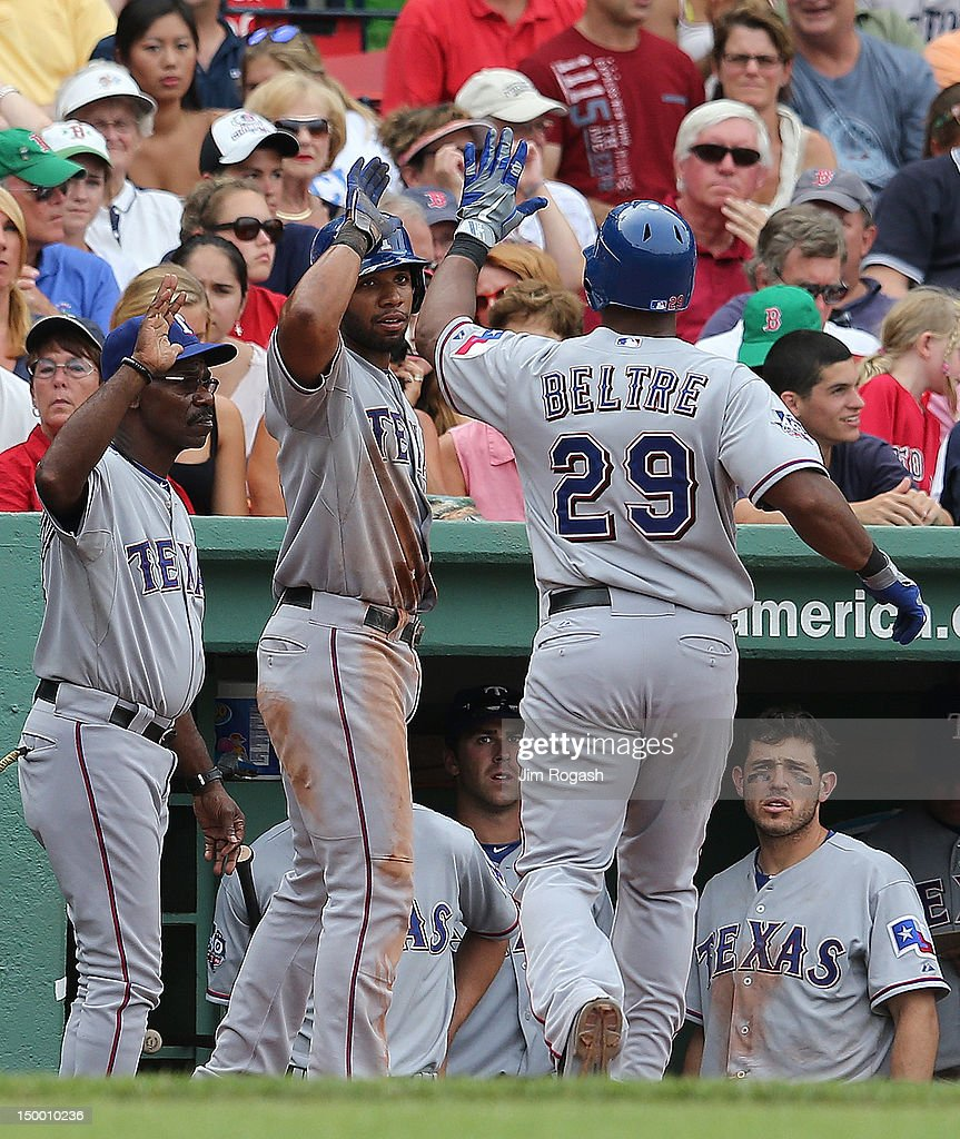 Adrian Beltre #29 of the Texas Rangers and Elvis Andrus #1 of the Texas Rangers celebrate in the ninth inning against the Boston Red Sox at Fenway Park August 8, 2012 in Boston, Massachusetts. Andus scored the winning run on a sacrifice fly by Beltre.
