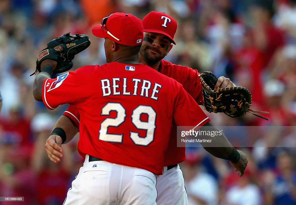 <a gi-track='captionPersonalityLinkClicked' href=/galleries/search?phrase=Adrian+Beltre&family=editorial&specificpeople=202631 ng-click='$event.stopPropagation()'>Adrian Beltre</a> #29 of the Texas Rangers and <a gi-track='captionPersonalityLinkClicked' href=/galleries/search?phrase=Mitch+Moreland&family=editorial&specificpeople=6824046 ng-click='$event.stopPropagation()'>Mitch Moreland</a> #18 embrace after a 6-2 win against the Los Angeles Angels at Rangers Ballpark in Arlington on September 29, 2013 in Arlington, Texas. The Rangers will now play a American League Wild Card tie-breaker game on Monday September 30, 2013.