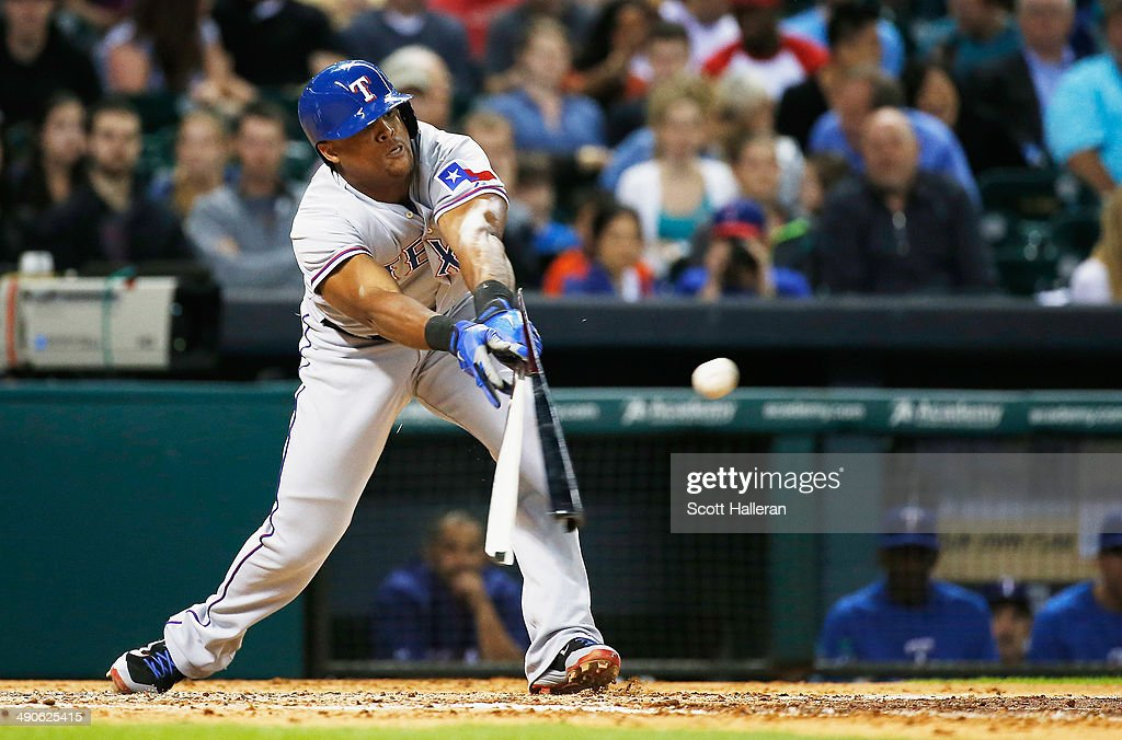 Adrian Beltre #29 of the Texas Rangers breaks his bat with an RBI single in the fifth inning of their game against the Houston Astros at Minute Maid Park on May 14, 2014 in Houston, Texas.