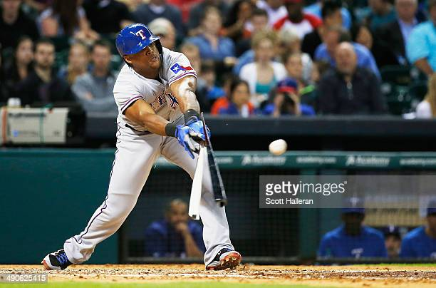 Adrian Beltre of the Texas Rangers breaks his bat with an RBI single in the fifth inning of their game against the Houston Astros at Minute Maid Park...