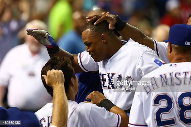 Adrian Beltre of the Texas Rangers celebrates after hitting a home run to complete the cycle in the fifth inning during a game against the Houston...