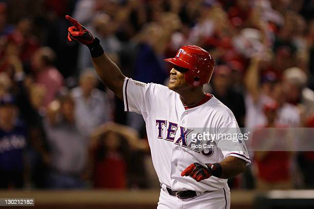 Adrian Beltre of the Texas Rangers celebrates after hitting a solo home run in the sixth inning during Game Five of the MLB World Series against the...
