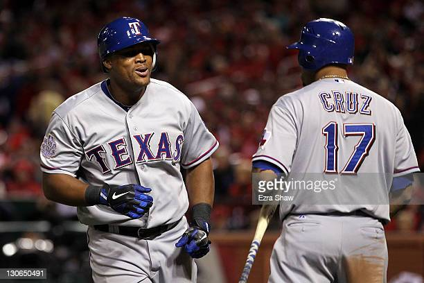 Adrian Beltre of the Texas Rangers celebrates with Nelson Cruz after hitting a solo home run in the seventh inning during Game Six of the MLB World...