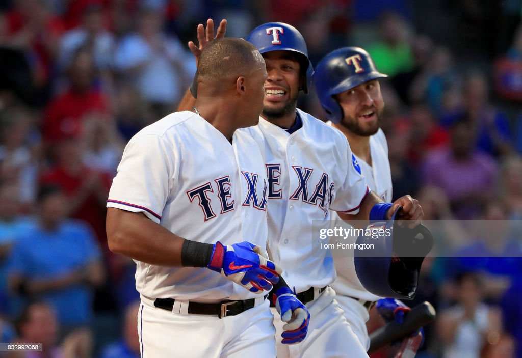 Adrian Beltre #29 of the Texas Rangers celebrates with Nomar Mazara #30 of the Texas Rangers and Elvis Andrus #1 of the Texas Rangers after hitting a two run home run against the Detroit Tigers in the bottom of the third inning at Globe Life Park in Arlington on August 16, 2017 in Arlington, Texas.