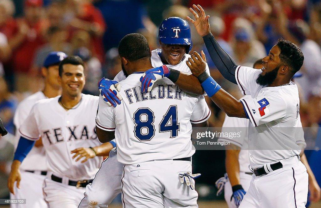 Adrian Beltre of the Texas Rangers celebrates with Prince Fielder of the Texas Rangers and Elvis Andrus of the Texas Rangers after hitting the game...