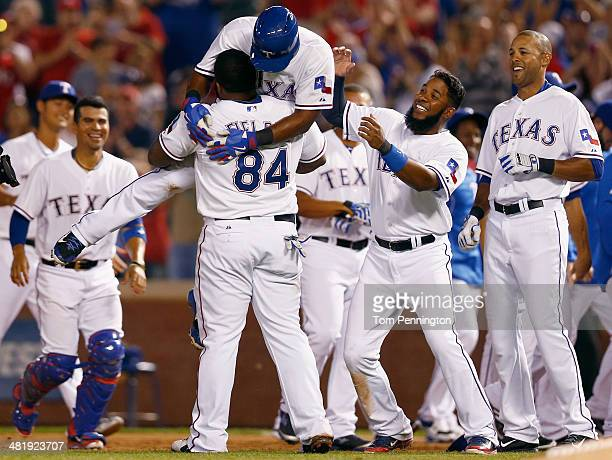 Adrian Beltre of the Texas Rangers celebrates with Prince Fielder of the Texas Rangers and Elvis Andrus of the Texas Rangers after hitting the game...