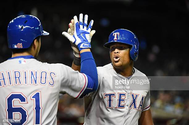 Adrian Beltre of the Texas Rangers celebrates with teammate Robinson Chirinos after hitting a ninthinning home run against the Arizona Diamondbacks...