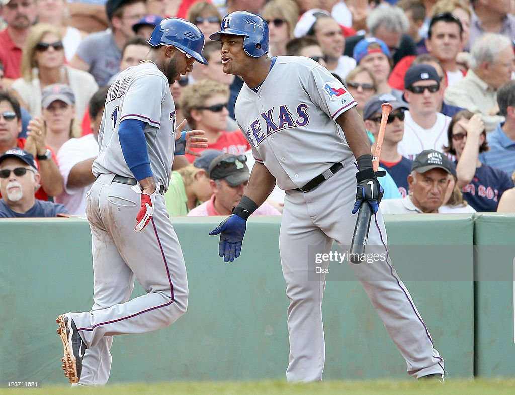 <a gi-track='captionPersonalityLinkClicked' href=/galleries/search?phrase=Adrian+Beltre&family=editorial&specificpeople=202631 ng-click='$event.stopPropagation()'>Adrian Beltre</a> #29 of the Texas Rangers congratulates <a gi-track='captionPersonalityLinkClicked' href=/galleries/search?phrase=Elvis+Andrus&family=editorial&specificpeople=4845974 ng-click='$event.stopPropagation()'>Elvis Andrus</a> #1 after Andrus scored a run in the sixth inning against the Boston Red Sox on September 4, 2011 at Fenway Park in Boston, Massachusetts.