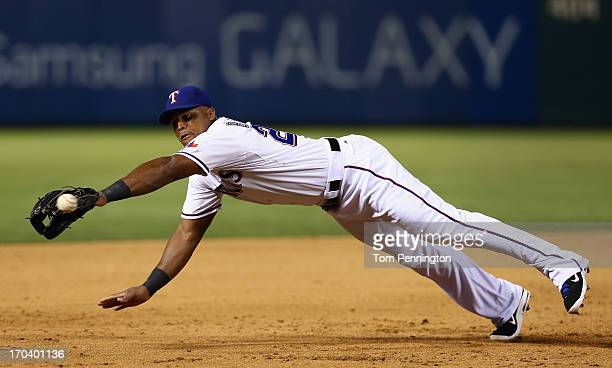 Adrian Beltre of the Texas Rangers dives for a foul ball hit a by the Cleveland Indians in the top of the ninth inning at Rangers Ballpark in...