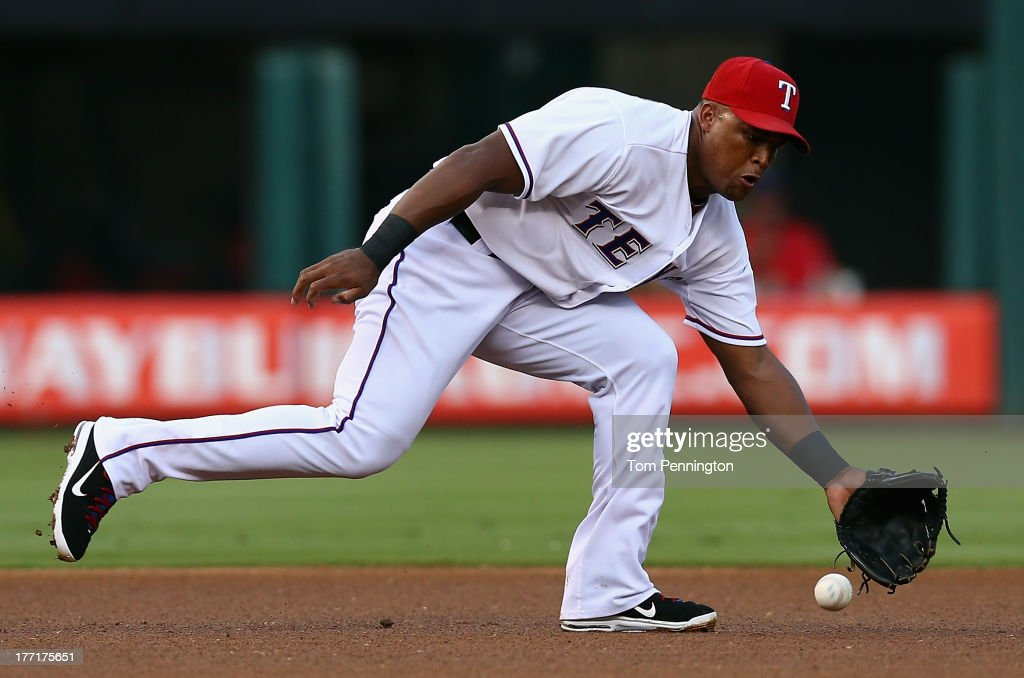 <a gi-track='captionPersonalityLinkClicked' href=/galleries/search?phrase=Adrian+Beltre&family=editorial&specificpeople=202631 ng-click='$event.stopPropagation()'>Adrian Beltre</a> #29 of the Texas Rangers dives to make the stop for the out on a line drive hit byJose Altuve #27 of the Houston Astros in the top of the first inning at Rangers Ballpark in Arlington on August 21, 2013 in Arlington, Texas.