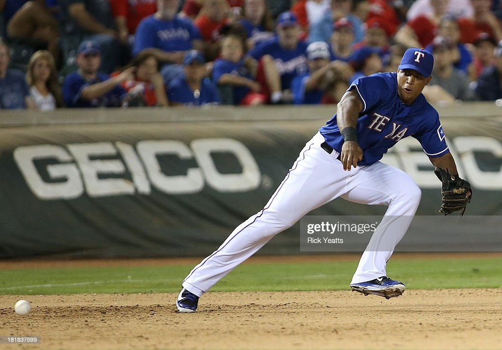 <a gi-track='captionPersonalityLinkClicked' href=/galleries/search?phrase=Adrian+Beltre&family=editorial&specificpeople=202631 ng-click='$event.stopPropagation()'>Adrian Beltre</a> #29 of the Texas Rangers fields a infield hit for the out on Brandon Laird #4 of the Houston Astros at Rangers Ballpark in Arlington on September 25, 2013 in Arlington, Texas.