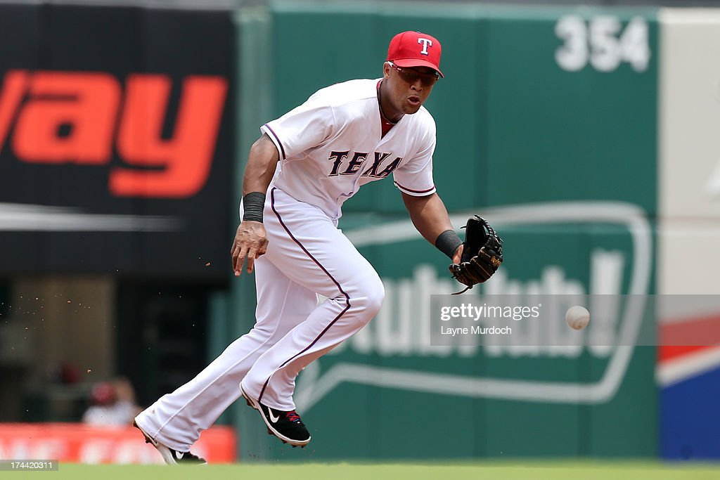 <a gi-track='captionPersonalityLinkClicked' href=/galleries/search?phrase=Adrian+Beltre&family=editorial&specificpeople=202631 ng-click='$event.stopPropagation()'>Adrian Beltre</a> #29 of the Texas Rangers fields the hit of Eduardo Nunez of the New York Yankees but is charged with a throwing error as Nunez is safe at first on July 25, 2013 at the Rangers Ballpark in Arlington in Arlington, Texas.