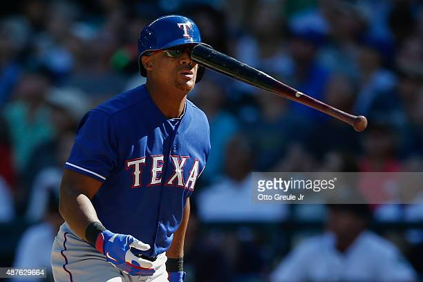 Adrian Beltre of the Texas Rangers flips his bat after swinging and missing in the ninth inning against the Seattle Mariners at Safeco Field on...