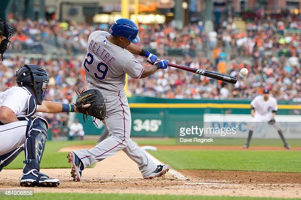 Adrian Beltre of the Texas Rangers get an RBI single in the third inning during a MLB game against the Detroit Tigers at Comerica Park on August 22...