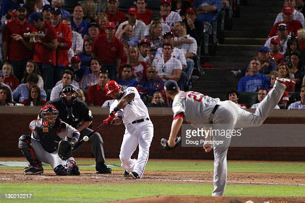 Adrian Beltre of the Texas Rangers hits a solo home run in the sixth inning off of Chris Carpenter of the St Louis Cardinals during Game Five of the...