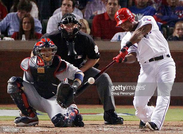 Adrian Beltre of the Texas Rangers hits a solo home run in the sixth inning during Game Five of the MLB World Series against the St Louis Cardinals...