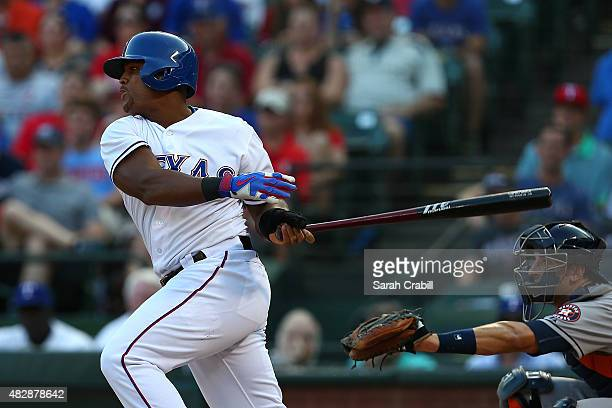 Adrian Beltre of the Texas Rangers hits a tworun RBI triple in the first inning during a game against the Houston Astros at Globe Life Park in...