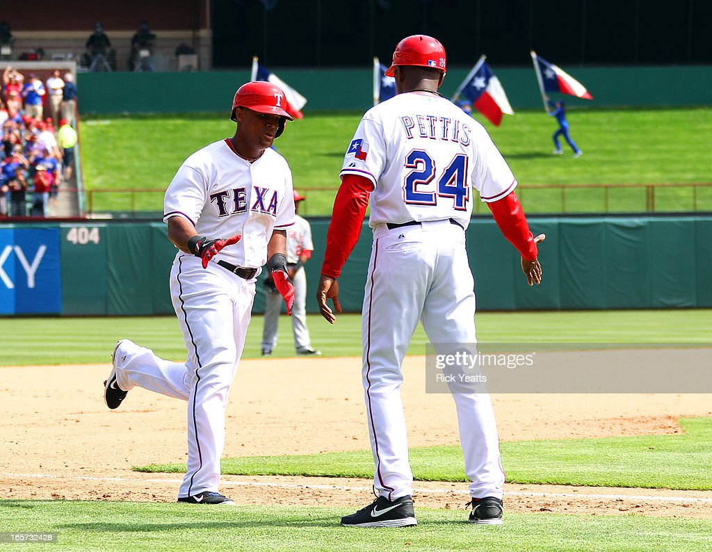 <a gi-track='captionPersonalityLinkClicked' href=/galleries/search?phrase=Adrian+Beltre&family=editorial&specificpeople=202631 ng-click='$event.stopPropagation()'>Adrian Beltre</a> #29 of the Texas Rangers is congratulated by first base coach Gary Pettis #24 for hitting a home run in the 7th inning against the Los Angeles Angels of Anaheim at Rangers Ballpark on April 5, 2013 in Arlington, Texas.