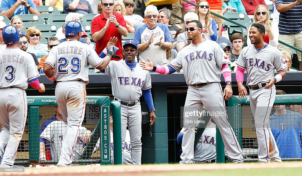 <a gi-track='captionPersonalityLinkClicked' href=/galleries/search?phrase=Adrian+Beltre&family=editorial&specificpeople=202631 ng-click='$event.stopPropagation()'>Adrian Beltre</a> #29 of the Texas Rangers is congratulated by manager Ron Washngton along with <a gi-track='captionPersonalityLinkClicked' href=/galleries/search?phrase=Nelson+Cruz&family=editorial&specificpeople=235459 ng-click='$event.stopPropagation()'>Nelson Cruz</a> and <a gi-track='captionPersonalityLinkClicked' href=/galleries/search?phrase=Elvis+Andrus&family=editorial&specificpeople=4845974 ng-click='$event.stopPropagation()'>Elvis Andrus</a> after umpires overturned a call that gave him a home run against the Houston Astros at Minute Maid Park on May 12, 2013 in Houston, Texas.