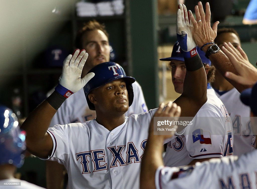 <a gi-track='captionPersonalityLinkClicked' href=/galleries/search?phrase=Adrian+Beltre&family=editorial&specificpeople=202631 ng-click='$event.stopPropagation()'>Adrian Beltre</a> #29 of the Texas Rangers is congratulated for hitting a home run in the sixth inning against the Los Angeles Angels of Anaheim at Globe Life Park in Arlington on July 10, 2014 in Arlington, Texas.