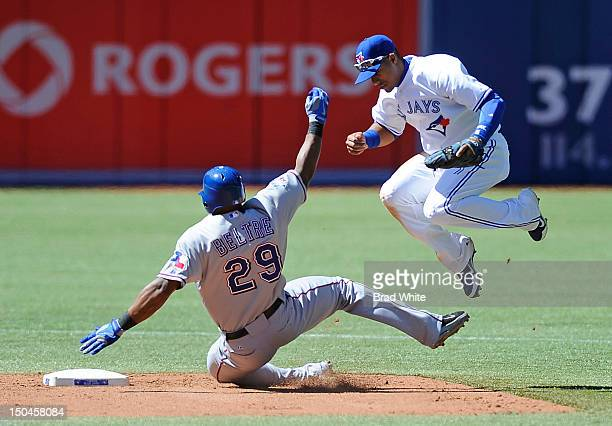 Adrian Beltre of the Texas Rangers is forced out at second by Yunel Escobar of the Toronto Blue Jays during MLB game action August 18 2012 at Rogers...
