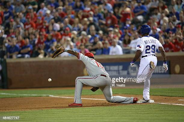 Adrian Beltre of the Texas Rangers is safe on first base on a throwing error to John Mayberry Jr #15 of the Philadelphia Phillies at Globe Life Park...