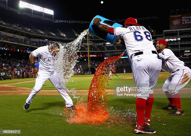 Adrian Beltre of the Texas Rangers is soaked with PowerAid by Hanser Alberto of the Texas Rangers and Rougned Odor of the Texas Rangers after the...
