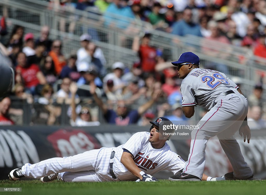 <a gi-track='captionPersonalityLinkClicked' href=/galleries/search?phrase=Adrian+Beltre&family=editorial&specificpeople=202631 ng-click='$event.stopPropagation()'>Adrian Beltre</a> #29 of the Texas Rangers looks on as <a gi-track='captionPersonalityLinkClicked' href=/galleries/search?phrase=Oswaldo+Arcia&family=editorial&specificpeople=8948415 ng-click='$event.stopPropagation()'>Oswaldo Arcia</a> #31 of the Minnesota Twins reacts to being called out at third base during the seventh inning of the game on April 28, 2013 at Target Field in Minneapolis, Minnesota. The Twins defeated the Ranger 5-0.