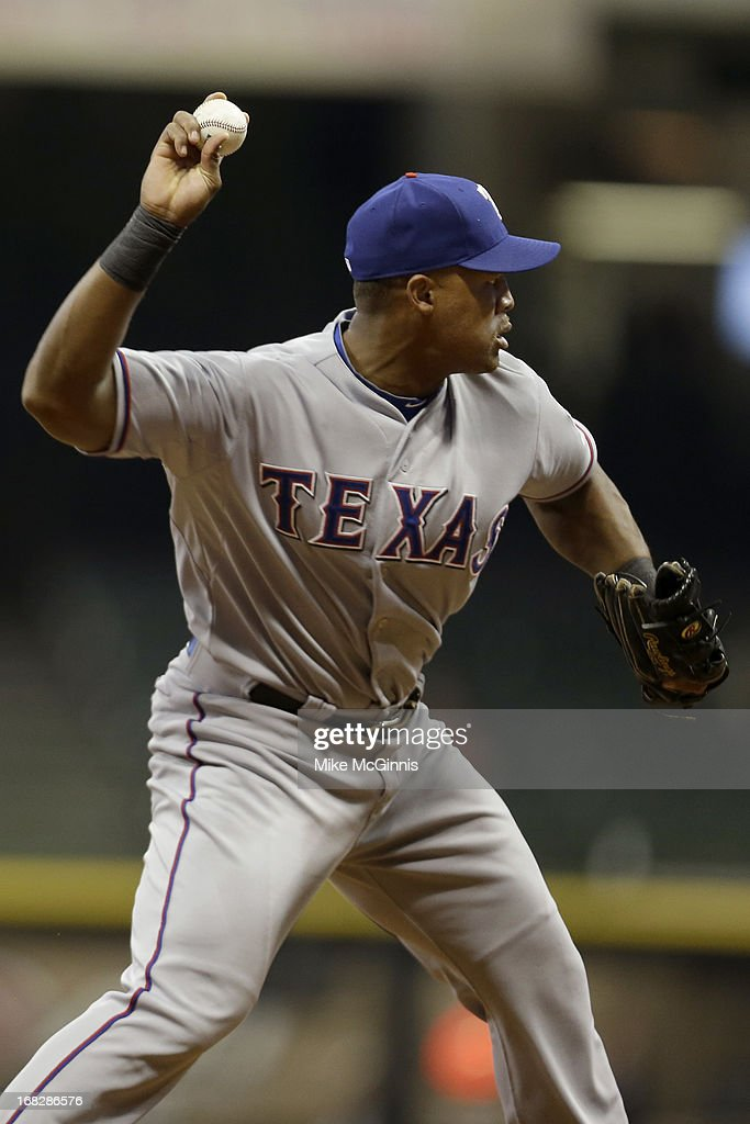 <a gi-track='captionPersonalityLinkClicked' href=/galleries/search?phrase=Adrian+Beltre&family=editorial&specificpeople=202631 ng-click='$event.stopPropagation()'>Adrian Beltre</a> #29 of the Texas Rangers makes the throw to first base to get Martin Maldonado of the Milwaukee Brewers out at first base during the bottom of the eighth inning at Miller Park on May 07, 2013 in Milwaukee, Wisconsin.